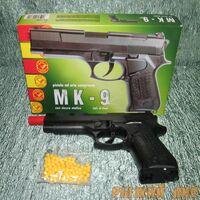 Пистолет с пульками МК-9