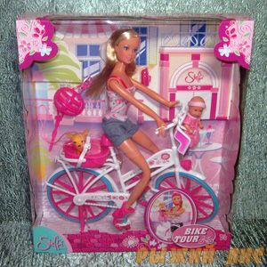 Кукла Штеффи на велосипеде
